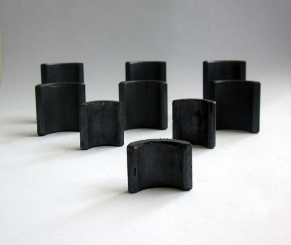 Wet pressure permanent magnet components