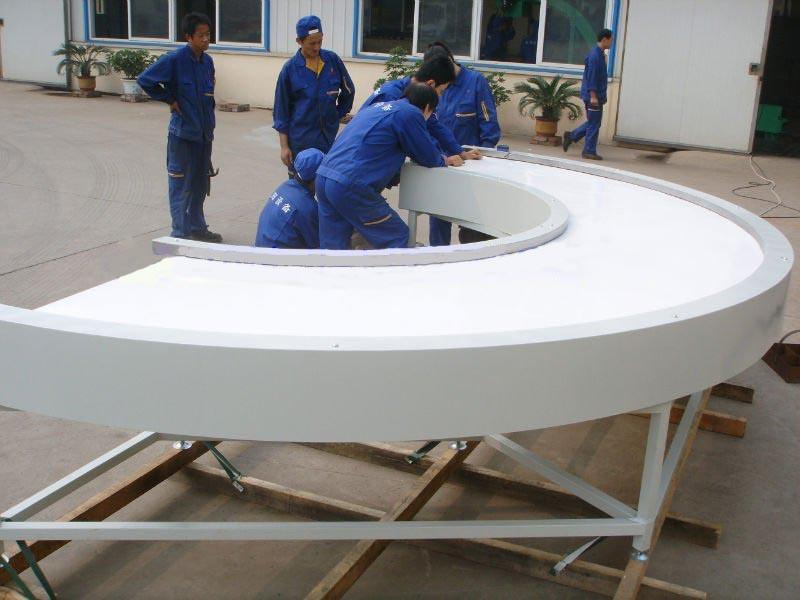 Inclined 180 degree turning conveyor