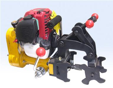 The rail drilling machine (Honda)