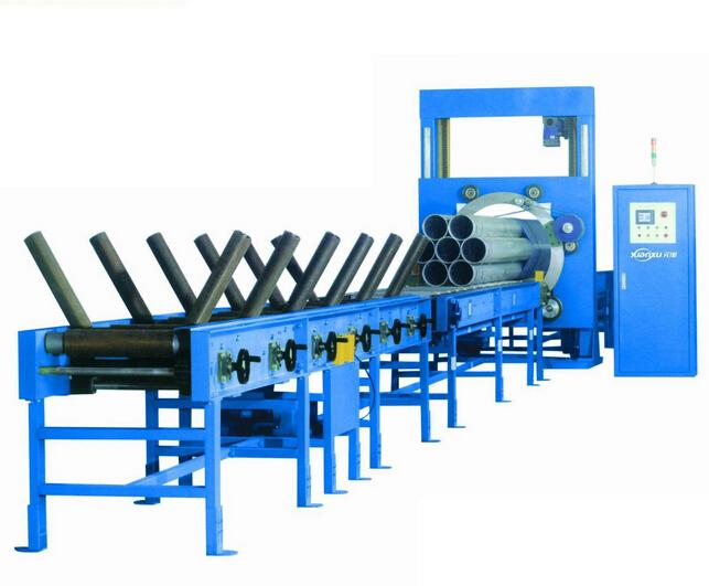 Устройство для упаковки стальных труб / устройство для упаковки дерева