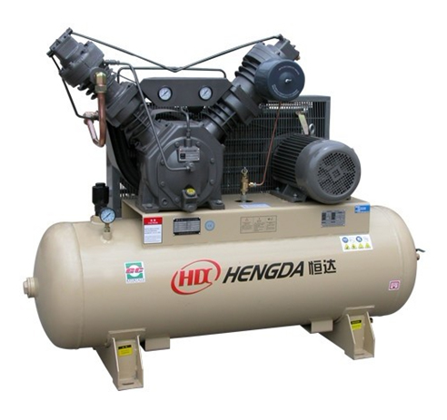 Oil-free low pressure piston compressor