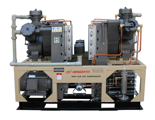 Oil-free high pressure piston compressor