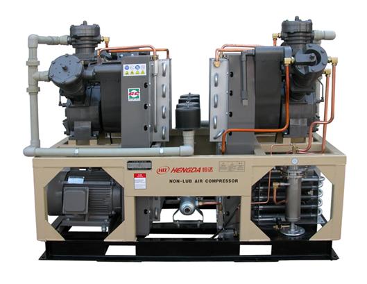 Oil-free high pressure piston compressor