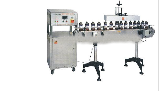 Shanghai Taoshan JT 2000 automatic aluminum foil bottle heat sealing machine