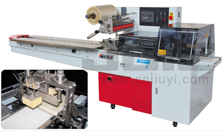 Automatic reciprocating flow wrapping machine